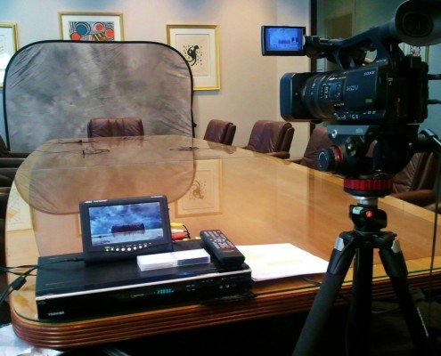Legal videographer's setup at a deposition